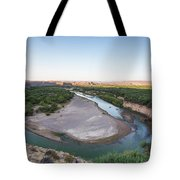 A Green River Curves Around A Deep Bend Tote Bag