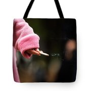 A Hand Holding A Cigarette Tote Bag