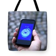 A Hand Holding A Digital Compass Tote Bag