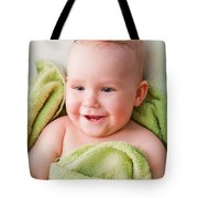 A Happy Baby Lying On Bed In Green Towel Tote Bag