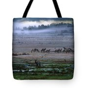 A Heard Of Elk Graze In A Misty Meadow Tote Bag