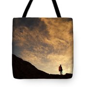 A Hiker Standing On A Ridge At Sun Rise Tote Bag