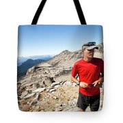 A Hiker Uses His Smartphone To Capture Tote Bag