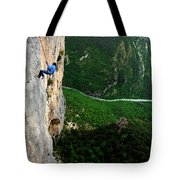 A Horizontal Image Of A Women In A Blue Tote Bag