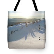 A Lone Skier Makes A Turn At Whitefish Tote Bag