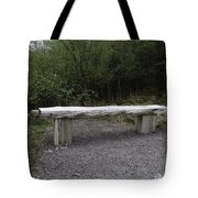 A Long Stone Section Over Wooden Stumps Forming A Rough Sitting Area Tote Bag
