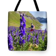 A Male Hiker In Sunny Flower Field Tote Bag