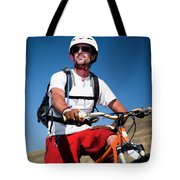 A Male Mountain Biker Stops To Enjoy Tote Bag