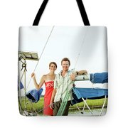 A Man And A Woman Embrace In Sailboat Tote Bag
