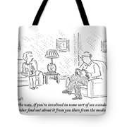 A Man And Woman Are Sitting Together In A Living Tote Bag
