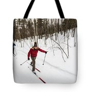 A Man And Woman Cross Country Skiing Tote Bag