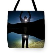 A Man Balances On A Log At Night Tote Bag