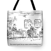 A Man Behind A Desk Gives The Man Sitting Tote Bag