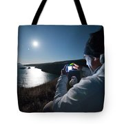 A Man Captures The Full Moon Tote Bag