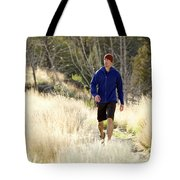 A Man In A Blue Jacket Walks Tote Bag