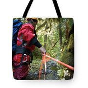 A Man Lowers A Rope For Canyoning Tote Bag