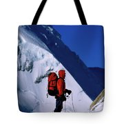 A Man Mountaineering In The Alps Tote Bag