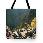 A Man Navigates A Rock Scree Field Tote Bag