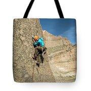 A Man Rock Climbing In Rocky Mountain Tote Bag