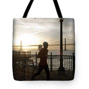A Man Running On A Dock In The Harbour Tote Bag