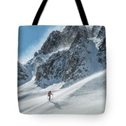 A Man Ski Touring In The Mountains Tote Bag