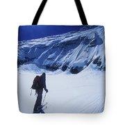 A Man Ski Touring Under Blue Skies Tote Bag