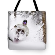 A Man Skiing Powder In The Trees Tote Bag