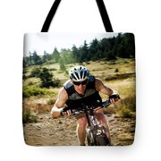 A Man Speeds Down A Trail On A Mountain Tote Bag