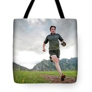A Man Trail Runs Along The Spring Brook Tote Bag