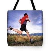 A Man Trail Runs In Salt Lake City Tote Bag
