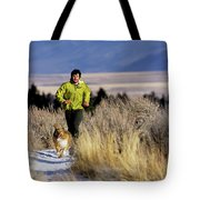 A Man Trail Runs On A Winter Day Tote Bag