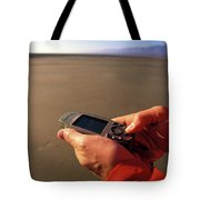 A Man Using A Gps Device At Sunset Tote Bag