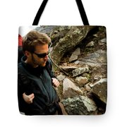 A Man Wearing A Backpack Hikes Tote Bag
