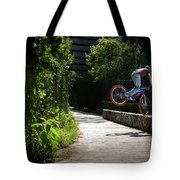 A Man With A Bike Standing On The Front Tote Bag