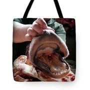 A Meat Seller Shows Off A Cow Snout Tote Bag