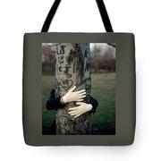 A Model Hugging A Tree Tote Bag