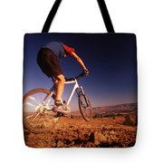 A Mountain Bike Rider On A Ride Tote Bag