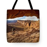 A Mountain Biker Rides By On Slickrock Tote Bag