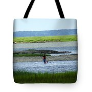 A Paddle Boarder Near The Cockspur Island Light House Tote Bag