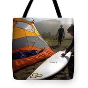 A Pair Of Surfers Prepare To Surf Tote Bag