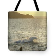 A Person Hiking On Rocky Shore Tote Bag