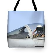 A Pilot Salutes Prior To Take Off In An Tote Bag