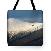 A Plane Flies In The Distance Over Mt Tote Bag