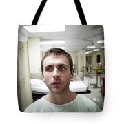 A Portrait Of A Young Man Sitting Tote Bag