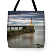 A Red And White Striped Lighthouse Tote Bag