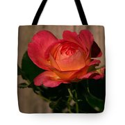 A Red Rosr Against A Weathered  Wood Background Tote Bag