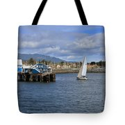 A Sailing Yacht Passes The Wharf In Sidney Harbour Tote Bag