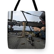 A Sailor Fires An M-240b Machine Gun Tote Bag by Stocktrek Images