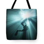 A Scuba Diver Ascends Into The Light Tote Bag by Michael Wood