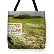 A Sign Warns Of Dangerous Unexploded Tote Bag